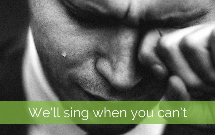 Man weeping: singing at funerals is difficult when you're crying