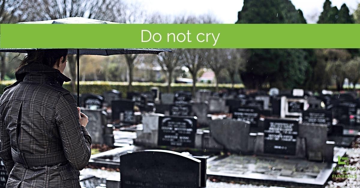 woman standing by grave - for funeral song Do not stand at my grave and weep